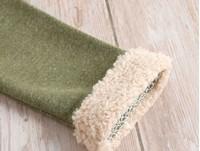Sudadera verde con huella